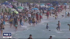 Despite warnings, mass closures, Pinellas County beaches remain open