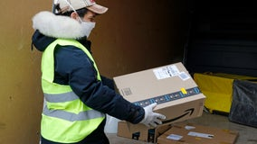 Some Amazon orders taking up to a month to ship as company announces delay on non-essential items