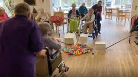 Seniors play life-size Hungry Hungry Hippos at British nursing home