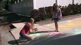 Families turn to sidewalk chalk to spread cheer amid coronavirus shutdown
