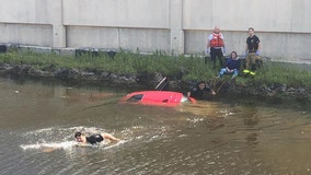 Florida woman rescued after crashing into canal