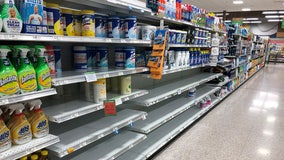 Stores step-up sanitary measures as shoppers stock-up to stay home