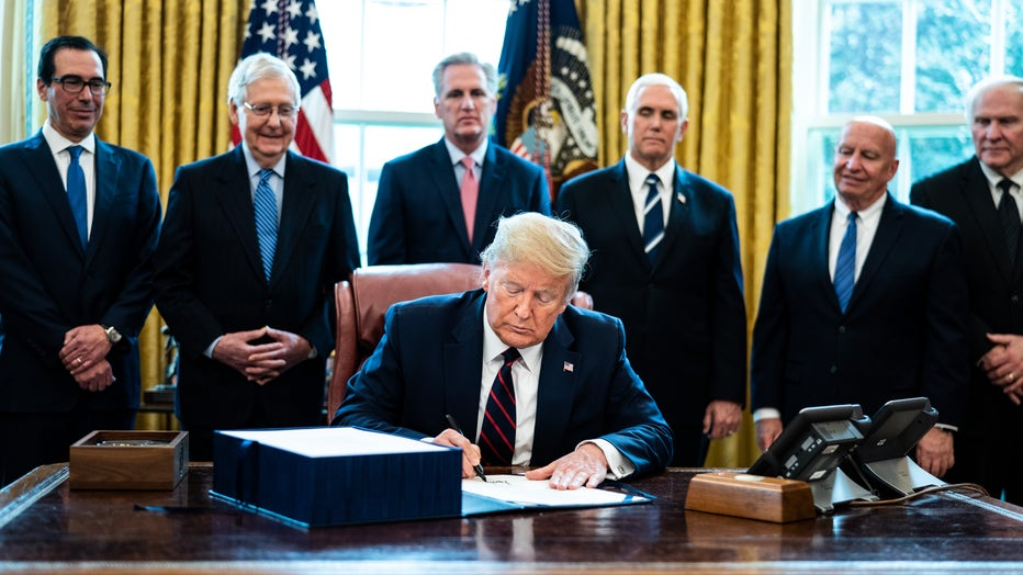 d26de78f-President Trump Signs Coronavirus Stimulus Bill In The Oval Office