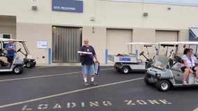 Drive-by retirement ceremony sends St. Petersburg College employee off in style