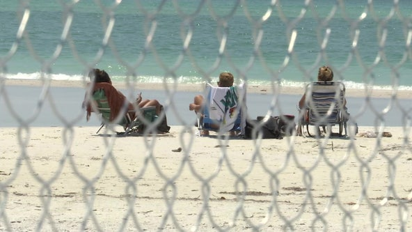 Siesta Key resident builds fence to keep peopleoff private beaches not closed under county order