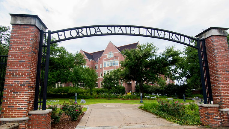 f41f60ca-Tallahassee Florida FSU college entrance to school with arch and brick campus