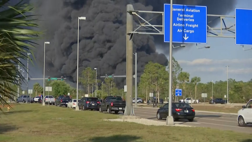 Brush fire ignites dozens of vehicles in Fort Myers airport parking lot