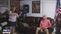 Violin-o-grams lift veterans' spirits
