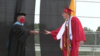 Clearwater Central Catholic High School seniors accept diplomas at unique, socially distant graduation