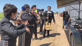Mariachi band serenades farmers in the field in show of appreciation