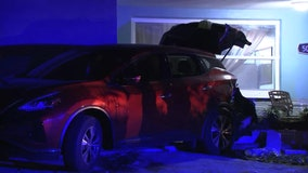 FHP:  20-year-old driver crashes into parked vehicles, home in Pasco County