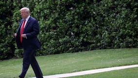 Pandemic politics: Maskless Trump visits Michigan Ford plant