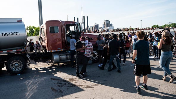 No injuries reported, driver arrested after truck drives into crowd of protesters in Minneapolis