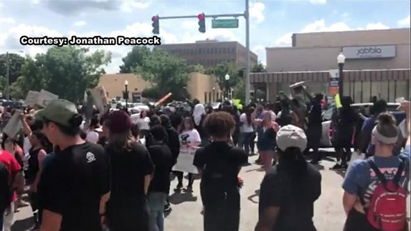 Police use tear gas to chase protesters from Lakeland intersection