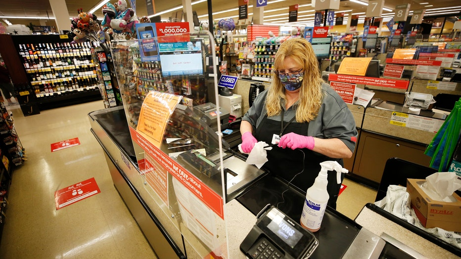 469269be-Dawn to dusk story on grocery store workers. Dan Graves store director of the Vons located at 24325 Crenshaw Blvd in Torrance starts the day early before doors open at 6 a..m. for seniors and at-risk shoppers due to the Coronavirus.