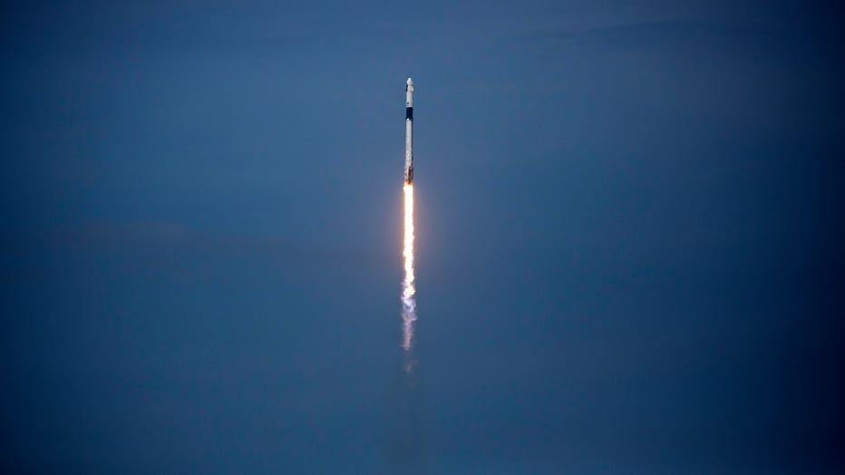 5112a19f-SpaceX Falcon-9 Rocket And Crew Dragon Capsule Launches From Cape Canaveral Sending Astronauts To The International Space Station