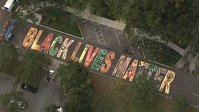 Volunteers paint 'Black Lives Matter' mural on St. Pete street