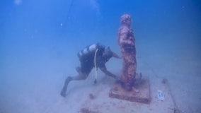 Disabled veterans dive to clean Pinellas Countyunderwater war memorial