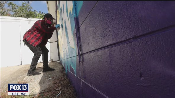Artists brighten bland laundromats with murals