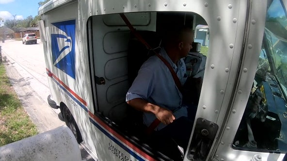 A letter carrier delivers praise to front-line workers in a unique way