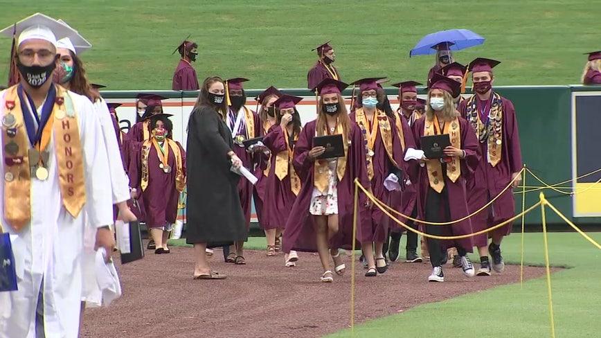 Rain didn't dampen the spirits of seniors graduating high school in Polk County Saturday