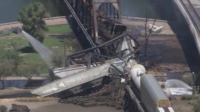 Rail bridge over Tempe Town Lake partially collapses following train derailment and fire