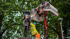 Black UK protester statue removed from pedestal in UK