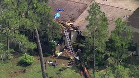 Fallen tree traps two inside Pasco County home