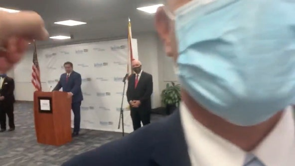 Protester yells 'shame on you' at DeSantis during COVID-19 press conference