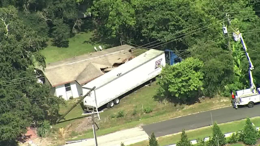 Tractor-trailer crashes into home on Maple Lane, near E Sligh Ave., Hwy 301 in Tampa