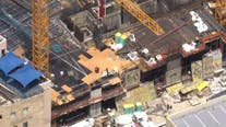 Rescuers free workers trapped in downtown Miami construction site