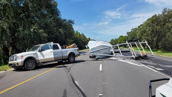 Overturned boat trailer blocks southbound I-75 lanes in Hillsborough