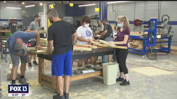 Students build picnic tables for outdoor classes at Wendell Krinn Technical High School