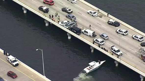 Northbound Howard Frankland Bridge closed after suspects jump into water after crash