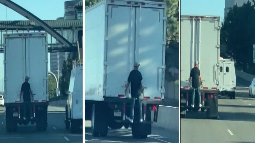 In viral video, man rides back of box truck on Colorado interstate