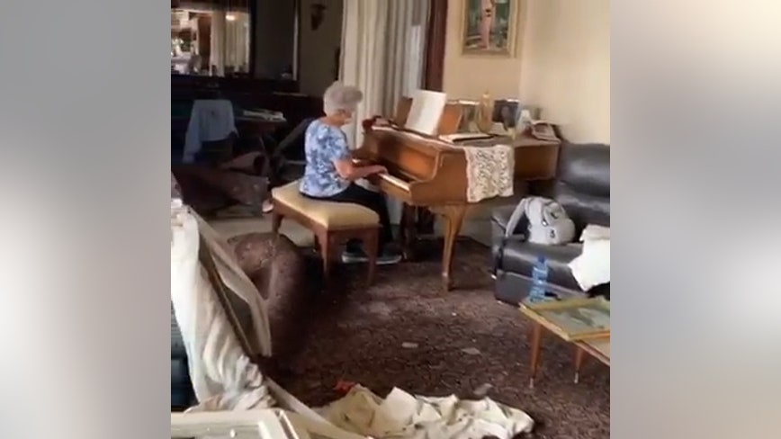Mother plays piano in home wrecked by explosion in Beirut