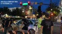 Raw video: Protesters throw skateboard, walk on car in St. Pete