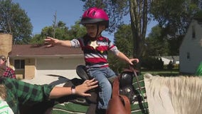 Michigan toddler with leukemia defies odds and is in remission; gets chance to be a real cowboy