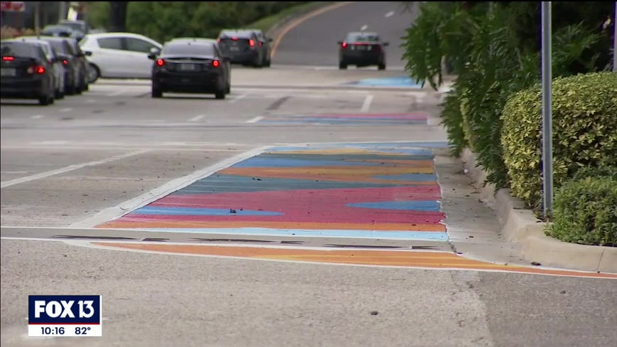 Colorful street murals aimed at keeping people safe