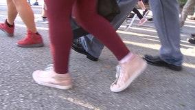 Students ditch carpool for sidewalks on 'Walk and Bike to School Day'