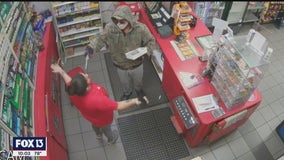 'The next one's for you:' Video shows suspect shoot toward store clerk during robbery
