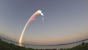 Sunset launch sends classified spy satellite to space; next crewed launch slides a day