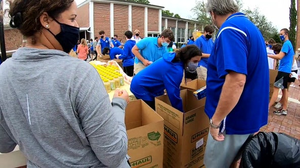 Jesuit High School students provide Thanksgiving meals for more than 200 families
