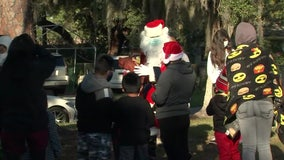 Santa makes early stop in Bradenton, hands out presents, food to families in need