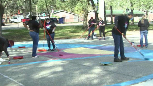 Volunteers 'paint the town' to brighten up Tampa's Uptown University Area