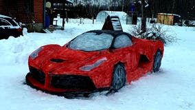 Couple carves their own life-size red Ferrari out of snow