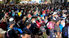 Thousands of asylum-seekers waiting in Mexico to be allowed into US
