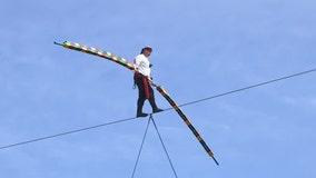 Daredevil Nik Wallenda, dressed as a pirate, walks wire across Legoland