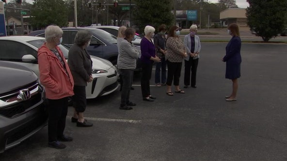 Church group prays for essential workers, patients every week outside Plant City hospital