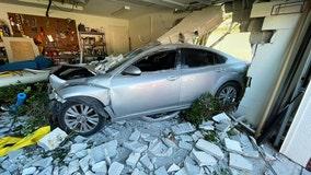 Driver hospitalized after crashing into Land O' Lakes home